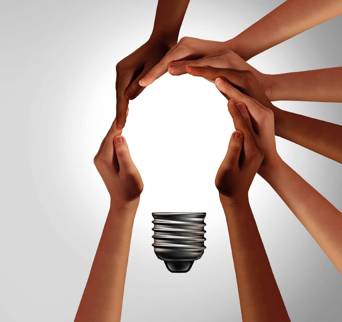 Hands together representing a light bulb glowing