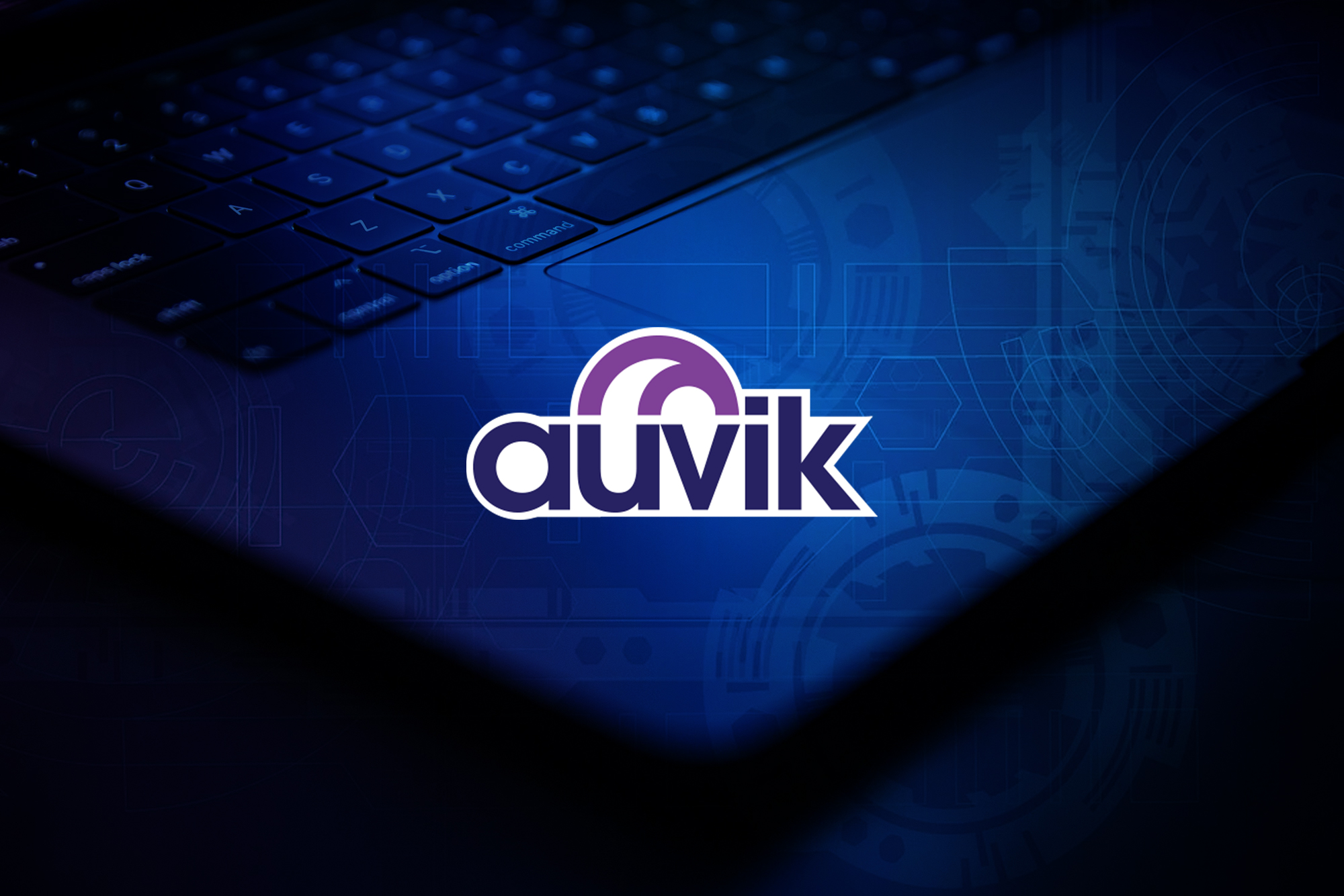 Dimly lit keyboard with Auvik logo over top