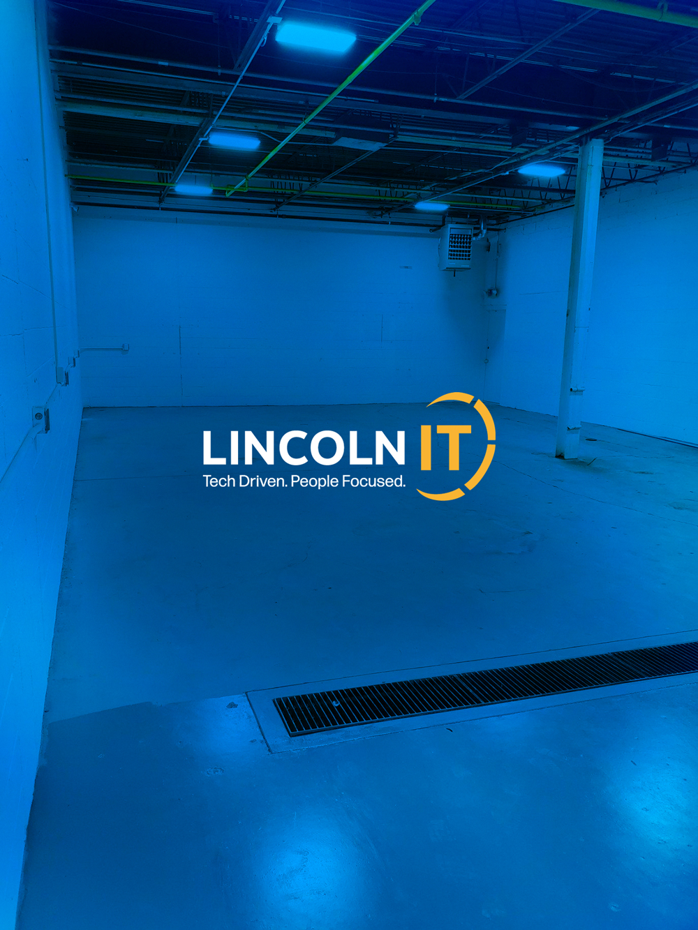 New empty warehouse with Lincoln IT Logo over top